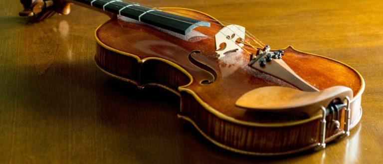 Violin on a wooden floor.