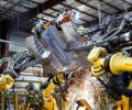 A factory robot assembling vehicle parts.